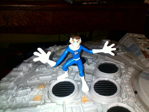 Nothing says Merry Christmas like Mr Fantastic doing jazz hands on top of the Millenium Falcoln.