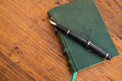 leather journal on desk