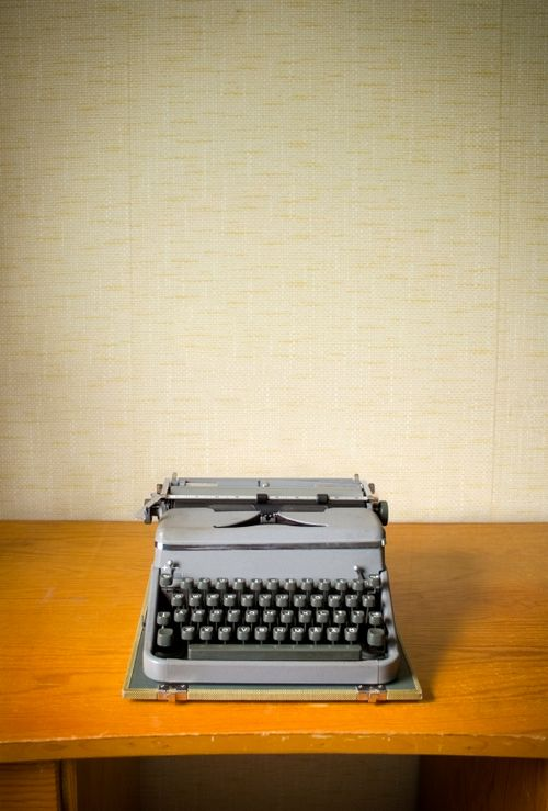 typewriter on wooden desk